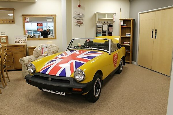 christies furniture store - sports car